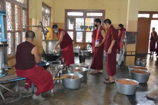 Sera Je monks help prepare meals for in the Sera Je Food Fund kitchen.