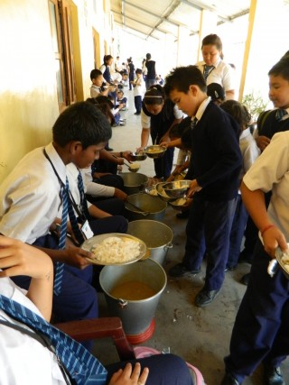 The young children of  Central School for Tibetans are offered a healthy vegetarian meal for lunch every day, offered through the Social Services Fund.