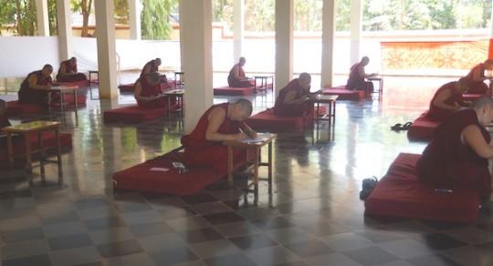 Nuns taking written exam for Geshe degree, Jangchub Choeling Nunnery, Mundgod, India, May 2015. Photo via Tibetan Nuns Project (tnp.org).