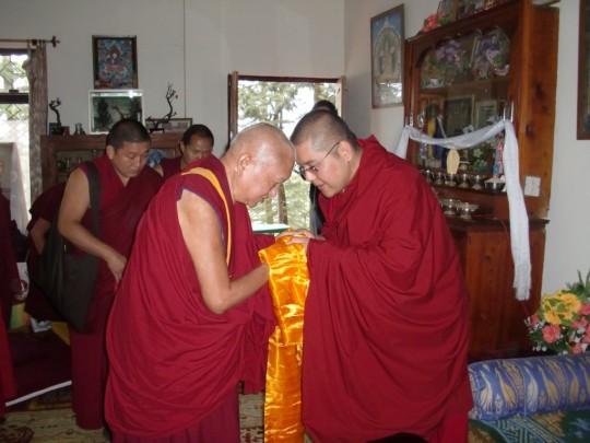 Lama Zopa Rinpoche greets is His Eminence Ling Rinpoche, Tushita Meditation Centre, Dharamsala, India, March 2015. Photo courtesy of Tushita Meditation Centre.