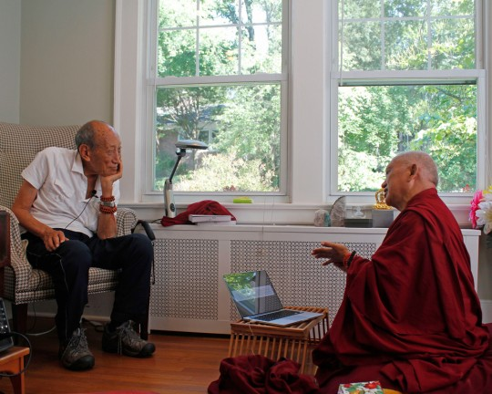 Lama Zopa Rinpoche chatting with Khyongla Rato Rinpoche during oral transmissions, New Jersey, August 2015. Photo by Ven. Lobsang Sherab.
