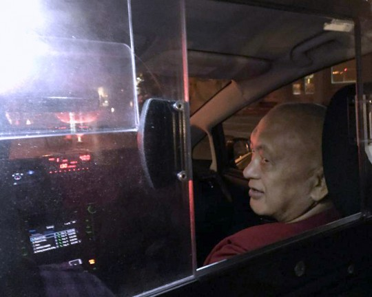 Lama Zopa Rinpoche in a Yellow Cab in New York City, US, August 2015. Photo by Ven. Roger Kunsang.