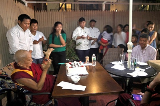 Lama Zopa Rinpoche at dinner with former Kopan monks and nuns, Queens, New York. Photo by Ven. Lobsang Sherab.