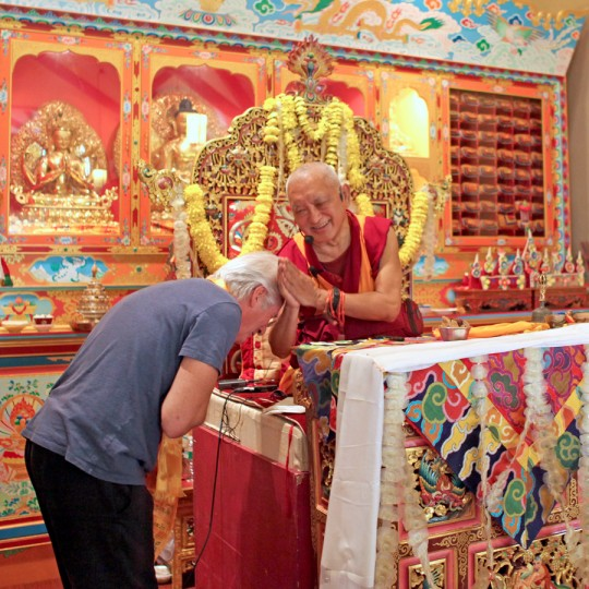 Lama Zopa Rinpoche thanking actor Richard Gere, Queens, New York, August 2015. Photo by Ven. Sherab.