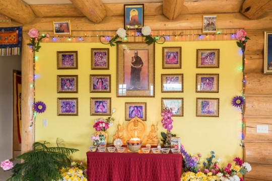 Extensive Offerings to holy objects and the Dalai Lama lineage. Photo by Chris Majors.
