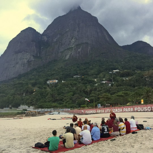 Lama Zopa Rinpoche with students from Centro Shiwa Lha blessing the ocean and all the creatures in it, Rio de Janeiro, Brazil, September 2015. Photo by Ven. Roger Kunsang.