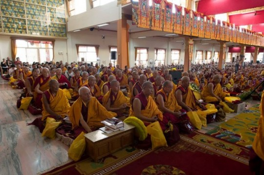 """Jangchup Lamrim teaching event, December 2013, Sera Je Monastery. Lama Zopa Rinpoche can be seen with Choden Rinpoche in the fourth row of this photo. Lama Zopa Rinpoche has explained, """"Making offerings to the Sangha is a way of collecting unbelievable merit because all the sangha are the pores of the guru. They are all disciples of the same guru – His Holiness the Dalai Lama. By offering to pores of the guru one collects more merit than offering to Buddha, Dharma, Sangha, as well as numberless statues, stupas."""" 17,000 students of His Holiness the Dalai Lama will be offered food during a three day teaching event at Tashi Lhunpo Monastery this December."""
