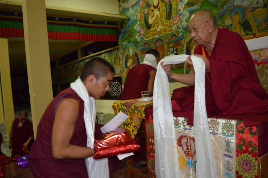 Sera Je Monastery monk receives new robes sponsored by the Supporting Ordained Sangha Fund in recognition of his memorization.