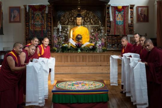 The monks of Tashi Lhunpo create a Chenrezig mandala and offer khata to His Holiness, Jamyang Buddhist Centre, London, UK, September 2015. Photo courtesy of Jamyang Buddhist Centre.