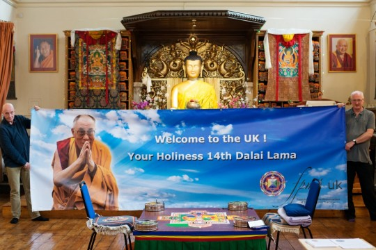 FPMT UK banner welcoming His Holiness the Dalai Lama held by Roy Sutherwood, director of Jamyang Buddhist Centre, and Mike Murray, SPC, in the gompa at Jamyang, London, UK, September 2015. Photo by Natascha Sturny.