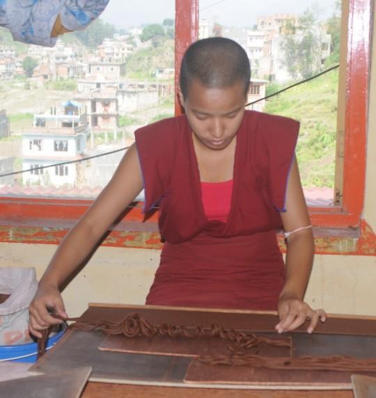 Kopan nun making incense, Pure Land Incense Factory, Khachoe Ghakyil Ling, Nepal. Photo courtesy of Khachoe Ghakyil Ling.