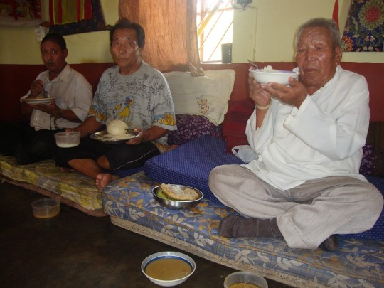 Residents of the Rabgayling Tibetan Settlement enjoying lunch offered by the settlement's elderly home.