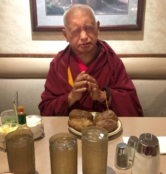 Lama Zopa Rinpoche blessing and offering a meal in California. November, 2015. Photo by Ven. Thubten Kunsang.