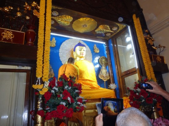 Robes offered to the Buddha inside Bodhgaya Mahabodhi temple, Bodhgaya, India. Lhabab Duchen, 2015.