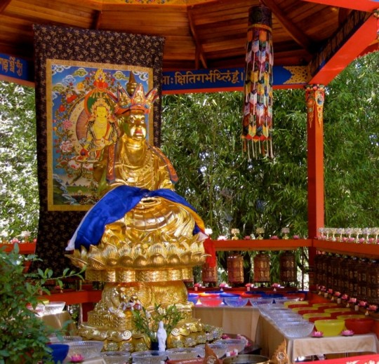 Kshitigarbha statue and large thangka with offerings during Kshitigarbha Day celebration at Land of Medicine Buddha in California, 2012.