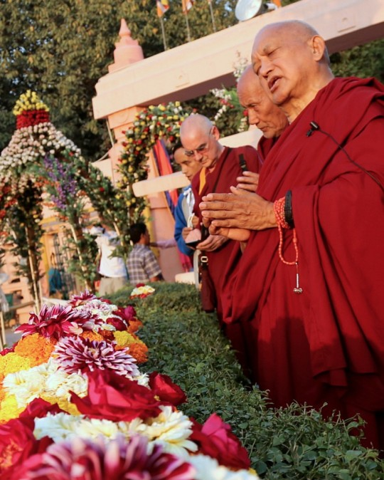 Lama Zopa Rinpoche at the Mahabodhi Stupa in Bodhgaya making offerings, February 2015. Photo by Ven. Thubten Kunsang.