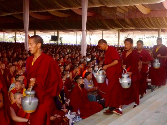 Monks with teapots during Jangchup Lamrim