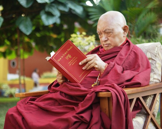 Lama Zopa Rinpoche with a copy of his new book How to Enjoy Death, Osel Labrang, Sera Monastery, India, December 2015
