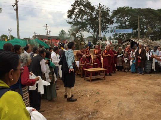 Lama Zopa Rinpoche blessing the site of the new community hall at the Tibetan settlement.