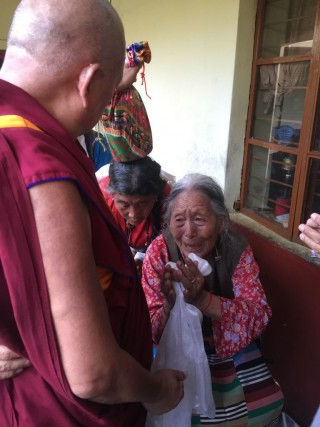 Lama Zopa Rinpoche blessing the members of the elderly home at the Tibetan Settlement.