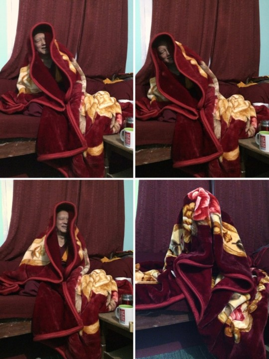 """Lama Zopa Rinpoche playfully wrapped himself in a blanket while dictating his letter for the Annual Review, Tso Pema, India, January 2016. """"It was very cold,"""" explained Ven. Holly, who was scribe for the letter."""