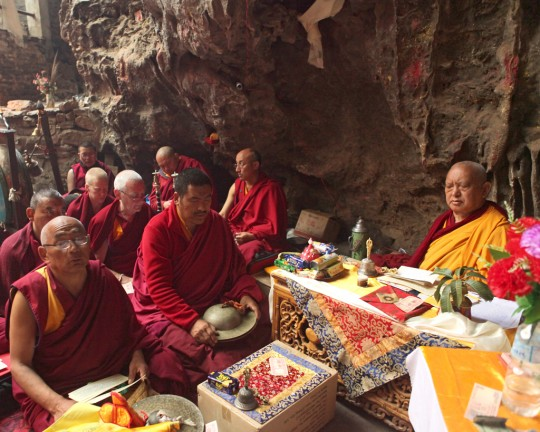 Lama Zopa Rinpoche with Sangha doing practice at Maratika Cave, Nepal, February 2016. Photo by Ven. Losang Sherab.