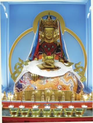 Shakyamuni Buddha in sambhogakaya aspect with offerings in the jokhang of Maitripa College. Photo by Noah Gunnell.