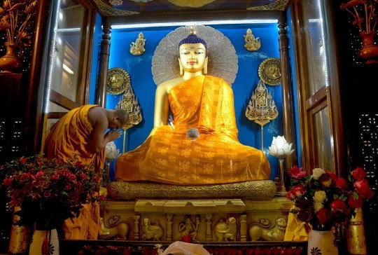 Robes offered to the Buddha statue in Mahabodhi temple, Bodhgaya, India, through the Puja Fund. July, 2015. Photo by Andy Melnic.
