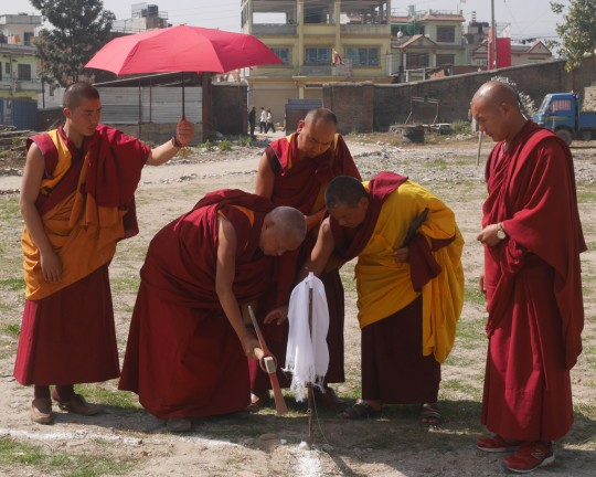 Lama Zopa Rinpoche breaking ground for the memorial stupa for Lama Lhundrup, Kopan Nunnery, Nepal, February 2016.