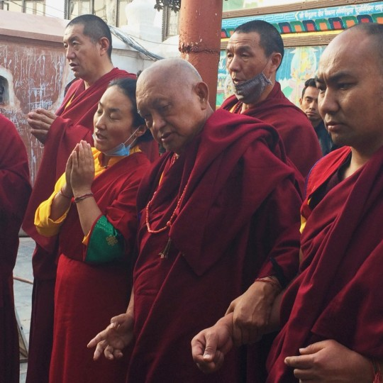 Lama Zopa Rinpoche and Khadro-la making prayers at Boudhanath, Nepal, February 2016