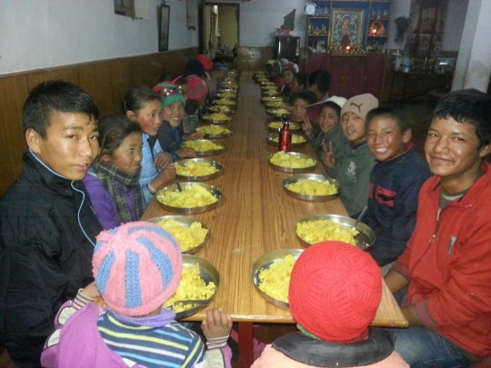 60 children, teachers, and young monks are offered food through the Social Services Fund.