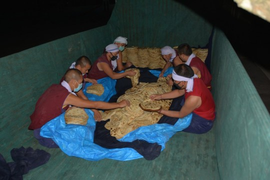 Bread for 30,000 getting carefully packed for transport to Tashi Lhunpo Monastery.