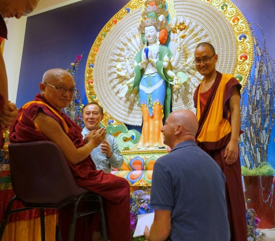 Lama Zopa Rinpoche with ABC director Hup Cheng Tan and Peter Griffin making offerings to ABC's new Chenrezig statue, February 2016.