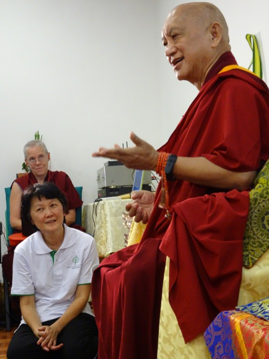 Lama Zopa Rinpoche and Goh Pik Pin, with Ven. Joan Nicell in back, at Kasih Hospice, Malaysia, April 2016. Photo by Ven. Roger Kunsang.