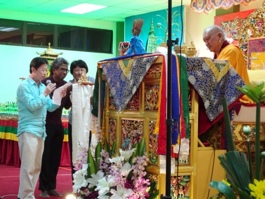 Daniel (director Penang) Jaya (representing Rinchen Jangsem Ling) and Goh Pik Pin, director of Losang Dragpa Centre, requesting Rinpoche to come back to Malaysia again, Penang, March 2016. Photo by Ven. Roger Kunsang.