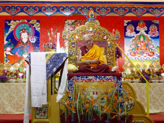 Lama Zopa Rinpoche teaching at the rented venue in Penang, Malaysia, March 2016. Photo by Ven. Losang Sherab. Chokyi Gyaltsen Center organized the teaching and arranged the incredible altar behind Rinpoche.