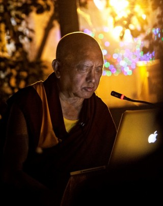 Lama Zopa Rinpoche reciting the Sutra of Golden Light at Mahabodhi Stupa, Bodhgaya, India, March 2014, Photo by Andy Melnic.