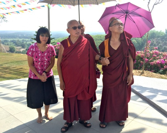 Lama Zopa Rinpoche with Selina Foong, director of Rinchen Jangsem Ling, and Ven. Losang Sherab, touring the retreat center grounds, Malaysia, April 2016. Photo by Ven. Roger Kunsang.