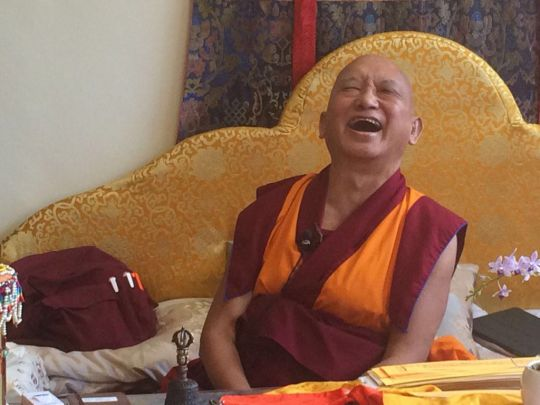 Lama Zopa Rinpoche enjoying a very funny moment, May 2016. Photo by Ven. Roger Kunsang via Twitter.