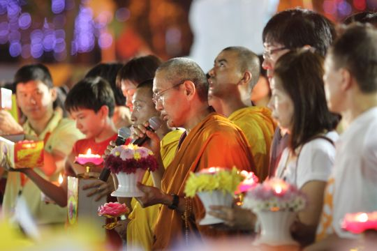 Khen Rinpoche Geshe Chonyi offers flowers and lights during Amitabha Buddhist Centre's annual Vesak Celebration, Singapore, May 2016. Photo by Tan Seow Kheng.