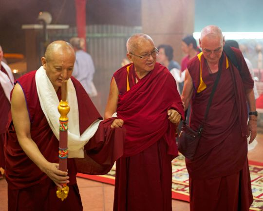 Lama Zopa Rinpoche arriving at Chokyi Gyaltsen Center, with resident teachers Geshe Deyang and Ven. Roger Kunsang, Panang, Malaysia, March 2016. Photo by Bill Kane.