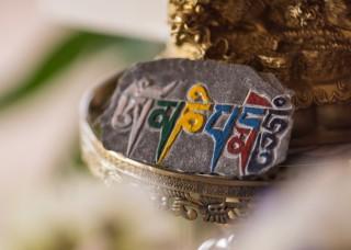 Mani stone at Rinpoche's house at Buddha Amitabha Pure Land, Washington, US. Photo by Chris Majors.