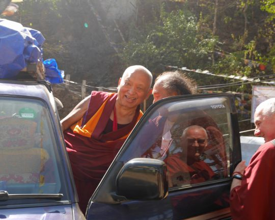Lama Zopa Rinpoche, with the assistance of Osel Dorje Rinpoche, departing from Maratika Caves, Nepal, Febraury 2016. Osel Dorje Rinpoche is a famous Nyingma lama and teacher of His Holiness the Dalai Lama. Photo by Ven. Losang Sherab.