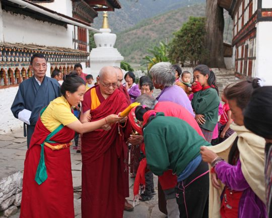 Khadro-la and Rinpoche blessing people with texts at Kyichu Lhakhang, Bhutan, May 2016. Photo by Ven. Lobsang Sherab.