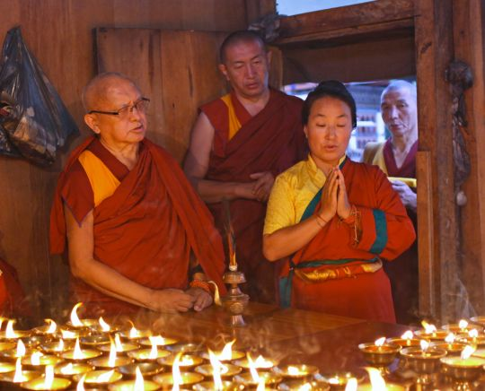 Rinpoche and Khado-la offering butter lamps at Kyichu Lhakhang, Bhutan, May 2016. Photo by Ven. Lobsang Sherab.