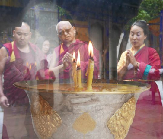Rinpoche and Khado-la offering a butter lamp at Kyichu Lhakhang, Bhutan, May 2016. Photo by Ven. Roger Kunsang.