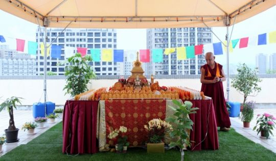 Lama Zopa Rinpoche circumambulates rootop veranda altar, Taiwan, May 2016. Photo by Ven. Lobsang Sherab.