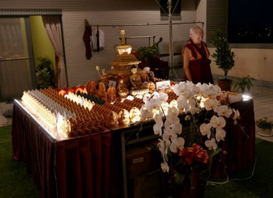 Lama Zopa Rinpoche circumambulates the rootop veranda altar at night, Taiwan, May 2016. Photo by Ven. Roger Kunsang.
