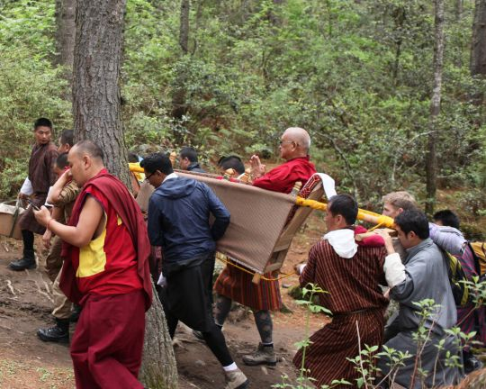 Twelve men carried the palanquin Lama Zopa Rinpoche needed to make the three-hour journey to Tiger's Nest Monastery, Bhutan, May 2016. Photo by Ven. Lobsang Sherab.