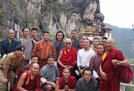 Lama Zopa Rinpoche, Geshe Tenzin Khenrab, the men who helped carry Rinpoche's palanquin, and others in front of Tiger's Nest Monastery, Bhutan, May 2016. Photo by Ven. Lobsang Sherab.